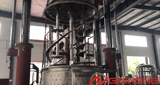 triple shaft mixer with auger, disperser and anchor stirrer